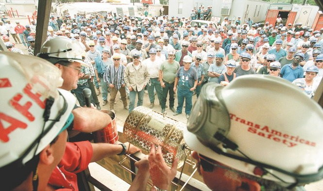 Construction workers wait for prize raffles during the rebuild of the Transamerican (now Orion) refinery in Norco, 1998. Transamerican was the last major rebuild of a large scale refinery in the Mississippi River corridor and plant officials had to deal with the New Sarpy community next door. Many of the workers hoped to get permanent high paying jobs with the company after it was built.