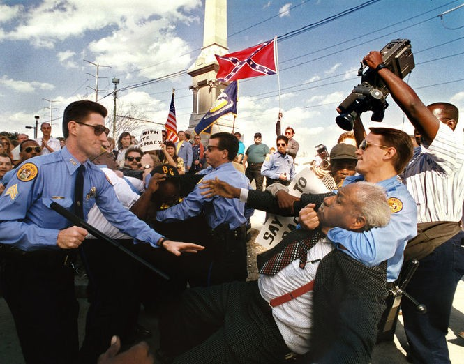 In this 1993 file photo, New Orleans police officers restrain the Rev. Avery Alexander, longtime civil rights leader and state representative, during a scuffle at the rededication ceremonies of the Liberty Monument. Alexander led an effort to disrupt the ceremony.