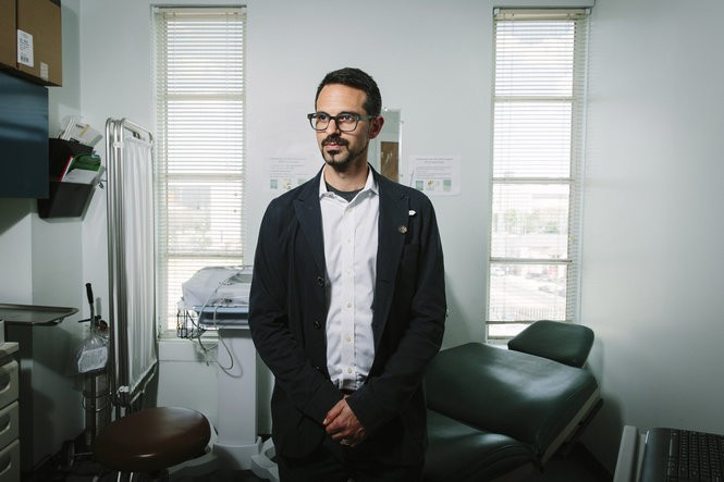 """""""The bottom line for me is my patients are developing organ damage and I have to wait until they have organ damage until I can access medication for hepatitis C,"""" said Jason Halperin, an infectious-disease clinician at CrescentCare, a federally qualified health center in New Orleans. (Photo for The Washington Post by Edmund D. Fountain)"""