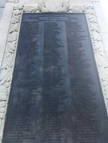 The plaque affixed to the Victory Arch monument in the Bywater segregates the names of black veterans from white veterans.