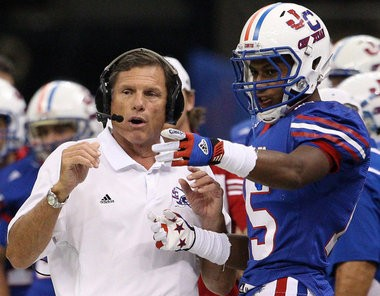 John Curtis coach J.T. Curtis speaks with former Patriot star Malachi Dupre in a game against Plant (Fla.) in 2013.