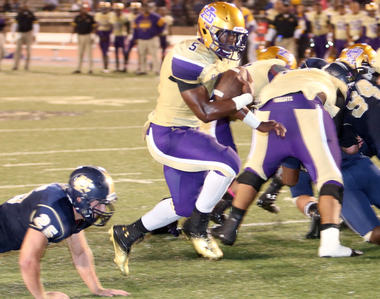 St. Aug running back Leonard Fournette (5) scores on a 2-yard run in the third quarter during the game between Holy Cross and St. Augustine at Tad Gormley Stadium on Saturday, October 26, 2013.