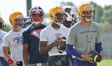 LSU commitment Feleipe Franks (right), Landry-Walker quarterback Keytaon Thompson (center), Jon Randall Belton (left) line up for a drill at the LSU prospect camp Thursday.