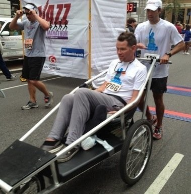 Former New Orleans Saints special teamer Steve Gleason is pushed by his brother-in-law, Vinnie Varisco, at the Jazz Half Marathon 0n Oct. 27 in New Orleans.
