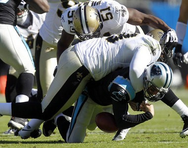 New Orleans Saints defensive tackle Sedrick Ellis knocked Carolina quarterback Matt Moore out of the game with this hit in 2010.