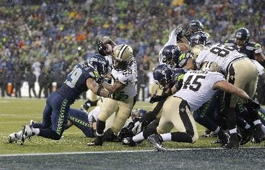 New Orleans Saints running back Khiry Robinson (29) scores a TD in the fourth quarter as Seattle Seahawks free safety Earl Thomas (29) defends during a NFC divisional playoff game at CenturyLink Fieldin Seattle, Jan.11, 2014. (David Grunfeld, Nola.com / The Times-Picayune)