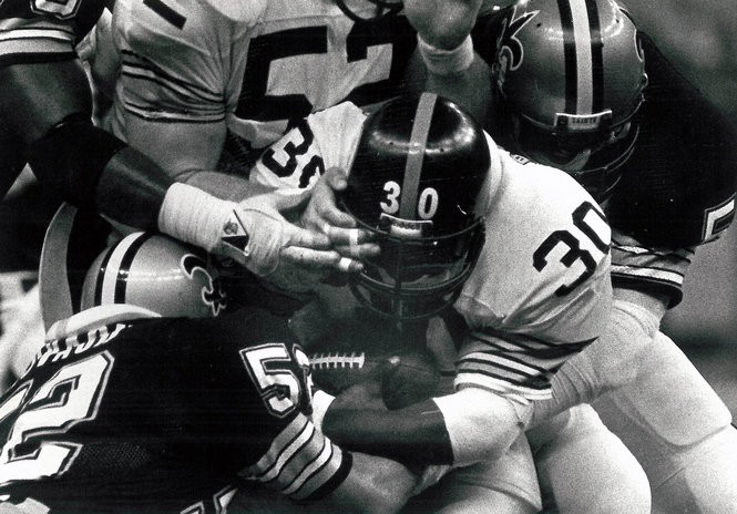 46be8b3137a Pittsburgh Steelers running back Frank Pollard gets poked in the eye during  a game against the New Orleans Saints on Monday, November 19, 1984.