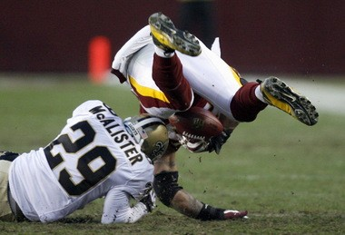 In overtime, Redskins fullback Mike Sellers fumbles away the football after a hit by Chris McAlister of the Saints, setting up the game-winning drive during the game between the New Orleans Saints and Washington Redskins at FedEx Field on Sunday, December 6, 2009. (MICHAEL DeMOCKER / THE TIMES-PICAYUNE)