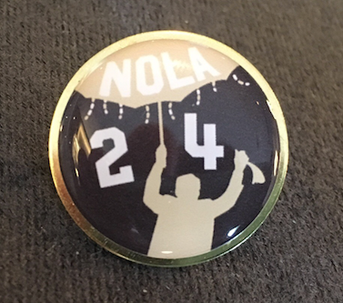 A pin highlighting late New Orleans Saints owner Tom Benson will be a keepsake as part of the city's pitch to land Super Bowl 2024.