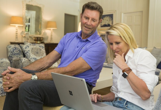 Baseball great Jim Palmer and his wife, Susan, who did the genealogical research on her husband by computer, in their Palm Beach, Fla., home on April 25, 2018. (Photo by Andrew Innerarity for The Washington Post)