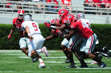 Chase Fourcade of the Nicholls State tries to scramble away from several Georgia defenders at Sanford Stadium on September 10, 2016 in Athens, Georgia. (Photo by Scott Cunningham/Getty Images)