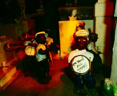 Clever dioramas, such as this one depicting the '9th Ward All Stars' leading a jazz funeral in New Orleans' St. Louis Cemetery, delight visitors with their animated, pushbutton-activated parts. (Photo by Kara Martinez Bachman)