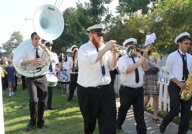 The Brass Marching Band of Southeastern Louisiana University led a rebirth second line through Madisonville on the one-year anniversary of Hurricane Issac. (Photo by Iris Vacante)