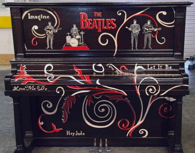 Slidell artist Lori Gomez spent more 300 hours restoring and painting the piano, seen here before McCartney and Starr signed it, with help with help from her husband, Mike, and musician friend Barney Floyd. Kim Bergeron for East St.