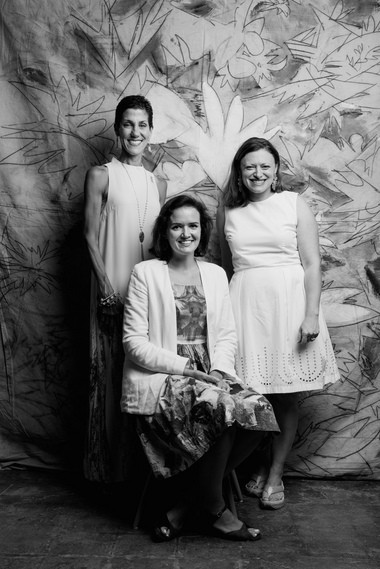 Arts advocate Mary Lee, left, Mia Kaplan, and Sarah Bonnette were photographed by Jamie and Heather Schneider of Dark Roux Portraits as part of a fundraiser for flood victims during Covington's White Linen for Public Art event. Aug. 20. (Dark Roux photo)