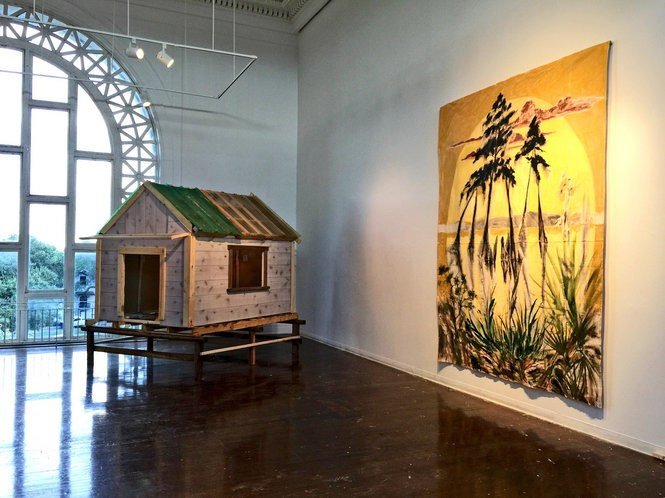 "Kaplan's ""Twilight and the Dance of Trees,"" an installation combining painting and sculptural pieces such as ""Sanctuary"" seen on the left, chronicles the Louisiana landscapes Kaplan explored as a child and returned to after Hurricane Katrina. (Sarah Bonnette photo)"