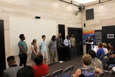 Caterina Picone (standing, right) conducts a Q&A session with students whose films screened at the 2018 Student Short Film Showcase of the Pontchartrain Film Festival.