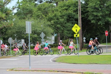 Riders wearing pink tutus enjoy the section of Tammany Trace that runs through downtown Abita Springs. The cyclists were part of an organized group ride held in conjunction with the Louisiana Bicycle Festival on June 16, 2018.