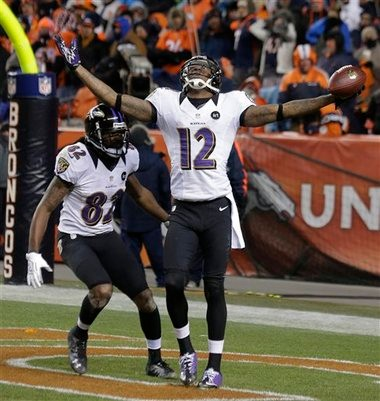 Baltimore Ravens wide receiver Jacoby Jones celebrates with wide receiver Torrey Smith after scoring a touchdown against the Denver Broncos to tie the score late in the fourth quarter of an AFC divisional playoff game, last Saturday in Denver.