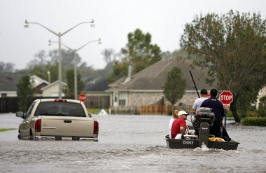 A Kenner Police boat makes its way through flood water in LaPlace, Thursday, August 30, 2012. Thousands of homes in St. John the Baptist Parish were flooded and damaged during Hurricane Isaac.