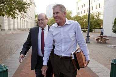 Mark Titus, right, is serving a five-year prison sentence as a result of his 2011 plea in the River Birch investigation.