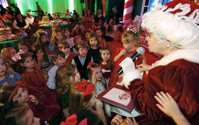 Mrs. Claus (Peggy Poche') has the children spellbound as she reads the Night Before Christmas during the Teddy Bear Tea at the Roosevelt Hotel in New Orleans. (Photo by Ted Jackson, NOLA.com / The Times-Picayune)