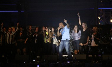 Flo Rida is joined onstage by fans during Rolling Stone's Super Bowl 2013 party at the Bud Light Hotel on Convention Center Boulevard on Feb. 1, 2013.