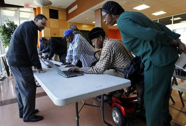 Residents of HANO's Guste High Rise, Pearlie Harris, 60, right, and Roosevelt Walker, 85, try to figure out how to maneuver around on the internet during a demonstration of the housing authority's new mobile computer lab. Thanks to a $75,000 donation, a new van equipped with nearly 16 laptop computers will travel on a coordinated schedule to allow residents access to the internet. The program was unveiled on Wednesday, February 27, 2013 in New Orleans. (Photo by Chris Granger, Nola.com | The Times-Picayune)