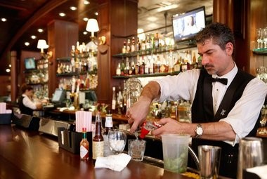 Bar manager Rich Nyikos pours a drink for a customer at Galatoire's 33 Bar & Steak on Friday, June 21, 2013.