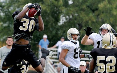Safety Akwasi Owusu-Ansah makes an interception during practice at Saints headquarters in Metairie on Wednesday, July 31, 2013. (Quentin Winstine, NOLA.com | The Times-Picayune)