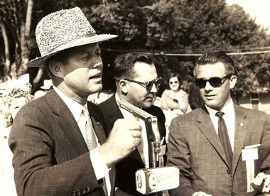 In mid October of 1959, Sen. John F. Kennedy and his wife Jacqueline visited Judge Edmund Reggie in Crowley, Reggie's hometown, attending the International Rice Festival, a parade and a dinner in Kennedy's honor. JFK wearing rice hat, flanked by Edwin Edwards. (Reggie Family Archives Photo)