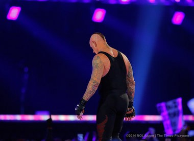 The Undertaker leaves after being pinned by Brock Lesnar, the first time in 21 years during WrestleMania XXX at the Superdome in New Orleans Sunday, April 6, 2014. (Photo by David Grunfeld, Nola.com |The Times-Picayune)