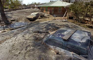 A truck, a Mustang, and a row of houses lie buried beneath feet of silt from the breach at the London Avenue Canal Sept. 21, 2005. (Photo by Ted Jackson, NOLA.com   The Times-Picayune archive)