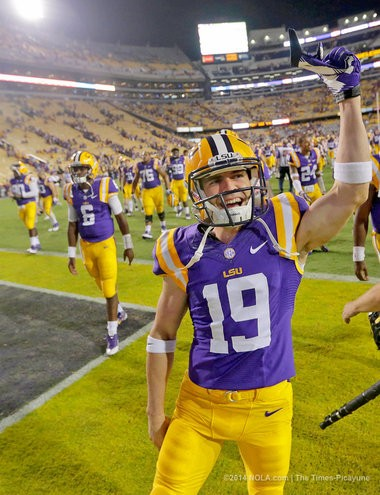 LSU senior Luke Boyd (19) celebrates after the Tigers wrapped up a 31-0 victory over ULM last week.
