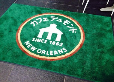 A green floor mat greets customers at the Cafe du Monde location in Kyoto Station in Kyoto, Japan. The New Orleans cafe au lait and beignets stand has around 20 licensed franchises in Japan, the result of a business partnership cultivated after the 1984 world's fair. (Photo by Jennifer Larino, NOLA.com | The Times-Picayune)
