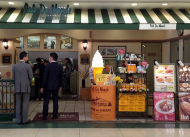 Customers wait to order at a Cafe du Monde store in Nagoya Japan. The New Orleans cafe au lait and beignets stand has around 20 licensed franchises in Japan, the result of a business partnership cultivated after the 1984 world's fair. (Image courtesy of Cafe du Monde)