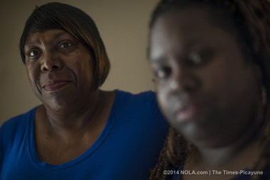 Della Morgan, left, mother of Clifton Morgan, and sister Felicia Wilson, say they got conflicting accounts of his death at Orleans Parish Prison and were eventually told if they wanted answers they should hire a lawyer. They did. They have filed a federal civil rights lawsuit saying the 27-year-old inmate's suicide was preventable. They were photographed in Metairie on Thursday, June 5, 2014. (Photo by Chris Granger, Nola.com | The Times-Picayune)