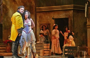 French singer Geraldine Chauvet plays Carmen in the New Orleans production of Bizet's opera. She headlines with superstar tenor, Bryan Hymel, pictured here. (Photo by Tom Grosscup)