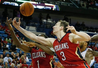 New Orleans Pelicans center Omer Asik (3) and New Orleans Pelicans guard Tyreke Evans (1) scramble for a reboud as the New Orleans Pelicans defeat the Orlando Magic 101-84 at the New Orleans Arena, Tuesday, October 28, 2014. (Photo by Ted Jackson)