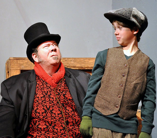 John 'Spud' McConnell returns to Southern Rep's production of 'A Christmas Carol' as Ebenezer Scrooge. Pictured with him is Danny Herre as Tiny Tim in the 2014 edition of the production. (Photo by John Barrois)