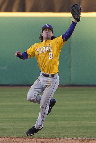 LSU infielder Kramer Robertson (3) makes a catch during practice at Alex Box Stadium in Baton Rouge on Thursday, February 5, 2015. (Photo by Brianna Paciorka, NOLA.com | The Times-Picayune)