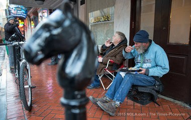 After sitting for hours, Russell Smith, right takes a break from the line and wanders down Bourbon to the International House of Pancakes on Canal St. for a stack of pancakes. He returns to his chair for his breakfast, a far cry from the meal awaiting his customers at Galatoire's, Friday, February 6, 2015. (Photo by Ted Jackson, Nola.com   The Times-Picayune)