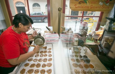 Krystal Crowden makes pralines at The New Orleans School of Cooking in New Orleans on Friday, April 24, 2015. The New Orleans School of Cooking will celebrate its 30th anniversary in June. (Photo by Brett Duke, Nola.com | The Times-Picayune)