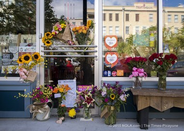 Flowers lay in front of Red Arrow Workshop in Lafayette on Friday, July 24, 2015. The shop is co-owned by Jillian Johnson, who was killed during a shooting at The Grand Theatre in Lafayette on July 23, 2015.