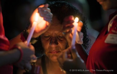 Sandra Allen reflects as her daughter Kirsten Allen and friend Ruben Henderson hold their candles as students hold a candlelight vigil on the Quad at the University of Louisiana Lafayette, Friday, July 24, 2015 following the shooting at the Grand Theatre. The victims were 21-year-old Mayci Breaux and Jillian Johnson, 33. (Photo by Ted Jackson, Nola.com | The Times-Picayune)