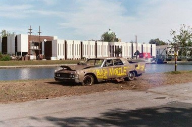 """A discarded car tagged the """"Bush Mobile"""" sits on the bank of Bayou St. John soon after Hurricane Katrina blasted the Gulf Coast and the federal levees broke, flooding New Orleans. (Photo courtesy of Gary A. Swenson)"""