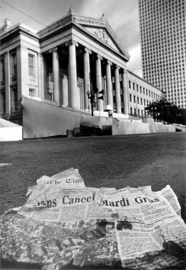 A week-old newspaper announcing the cancellation of Mardi Gras blows past Gallier Hall on Fat Tuesday 1979. 'The street, normally wall-to-wall with people awaiting the Rex parade at this time of day, played host to only a solitary pair of strollers walking past empty Carnival stands,' read the caption for the photo, which adorned the front page of The Times-Picayune on Feb. 28, 1979. A nearly three-week police strike that year prompted the first peacetime cancellation of Fat Tuesday celebrations in the city since Reconstruction. (G.E. Arnold/ The Times-Picayune)