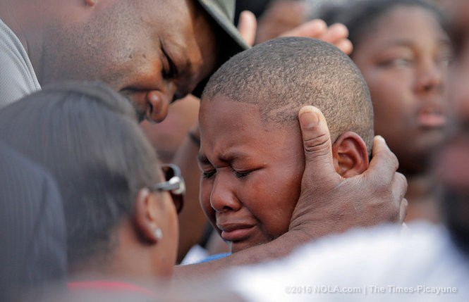 Cameron Sterling, the son of Alton Sterling, is overcome with emotion during a vigil for Alton Sterling at the Triple S Food Mart in Baton Rouge, Wednesday, July 6, 2016. Sterling was shot dead by Baton Rouge Police at the food mart on Tuesday (July 5).(Photo by Brett Duke, Nola.com | The Times-Picayune)