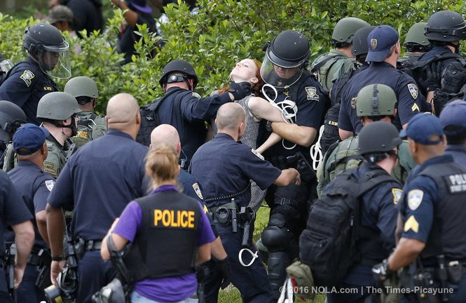 Police arrest a protestor, center, during a face off in Baton Rouge on Sunday, July 10, 2016, days following the Alton Sterling shooting (Photo by Chris Granger, Nola.com | The Times-Picayune)