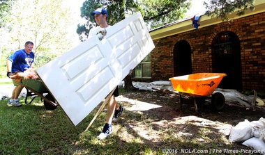 Members of the UNO basketball team muck out the home of Elbert and Ione Norred in Holden, La., August 21, 2016 which was heavily damaged by last weekend's floodwaters. (Photos by G. Andrew Boyd, NOLA.com | The Times-Picayune)